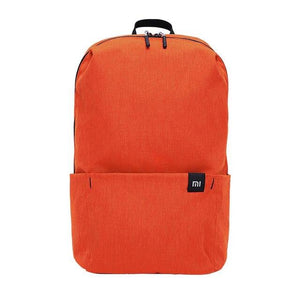 a small backpack in orange