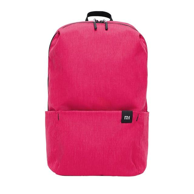 a small backpack in pink