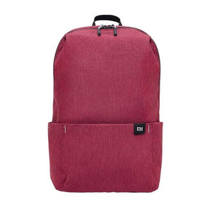 a small backpack in red wine color