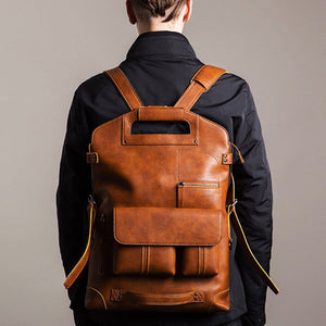 a guy carrying a leather backpack