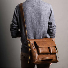 Load image into Gallery viewer, a guy carrying a leather backpack