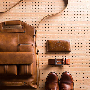 leather backpack with a vintage style, a wallet, a belt and, a pair of shoes