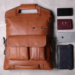 vintage leather backpack with a phone and a wallet next to it