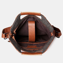 Load image into Gallery viewer, the internal pocket of a vintage leather backpack