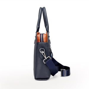 the left side of a blue navy and orange briefcase.