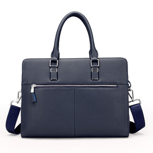 the backside of a blue navy leather briefcase