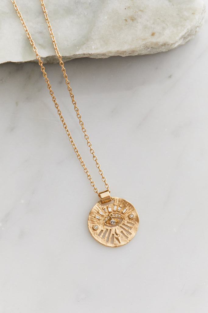 Gold Medal Dangling Diamond Eye Necklace