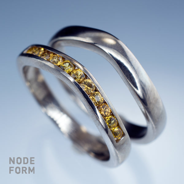 contoured white gold wedding bands with channel set yellow sapphires