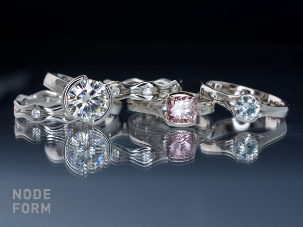 handmade engagement rings with moissanites, tourmaline and Montana sapphire