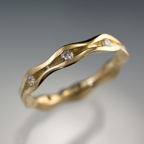 moissanite wave eternity ring in 14k gold