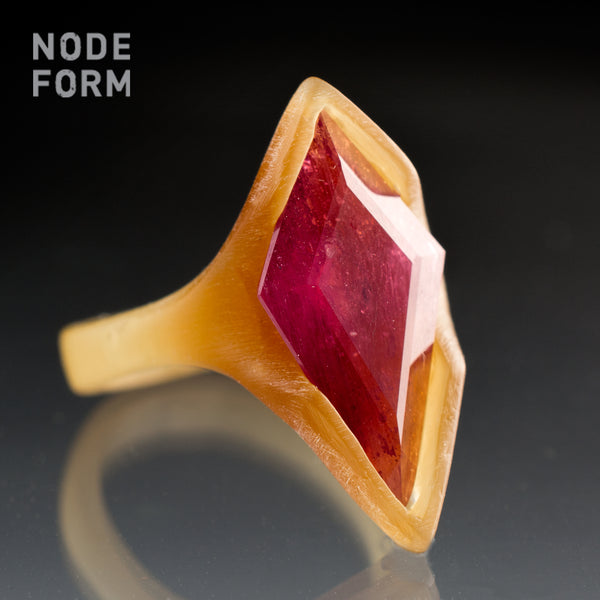 wax model for Secrete Santa ring with a large pink sapphire