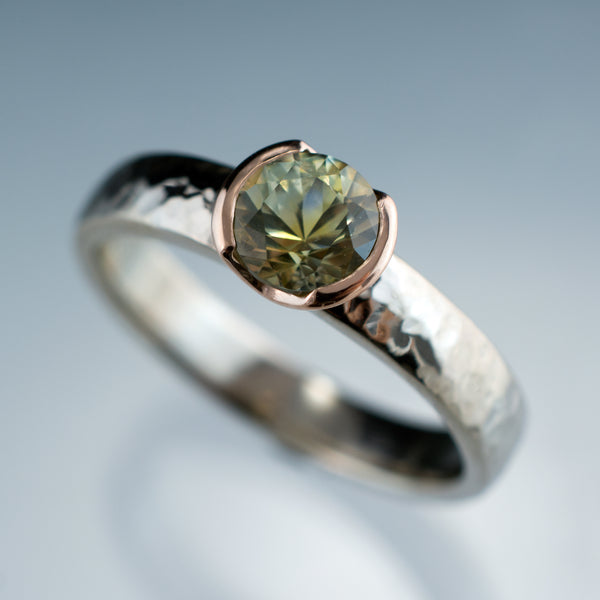Green Montana sapphire set in rose gold with a hammered band