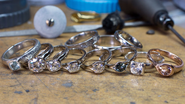 lot's of finished engagement rings on bench