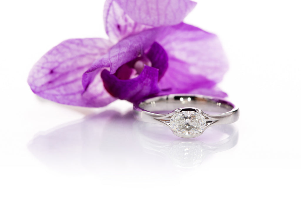 0.5ct oval diamond Fold engagement ring in platinum