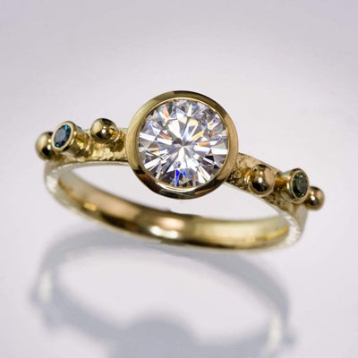 Lightly Textured Engagement Ring Bezel Set Round Moissanite & Blue and Teal Diamonds Accents