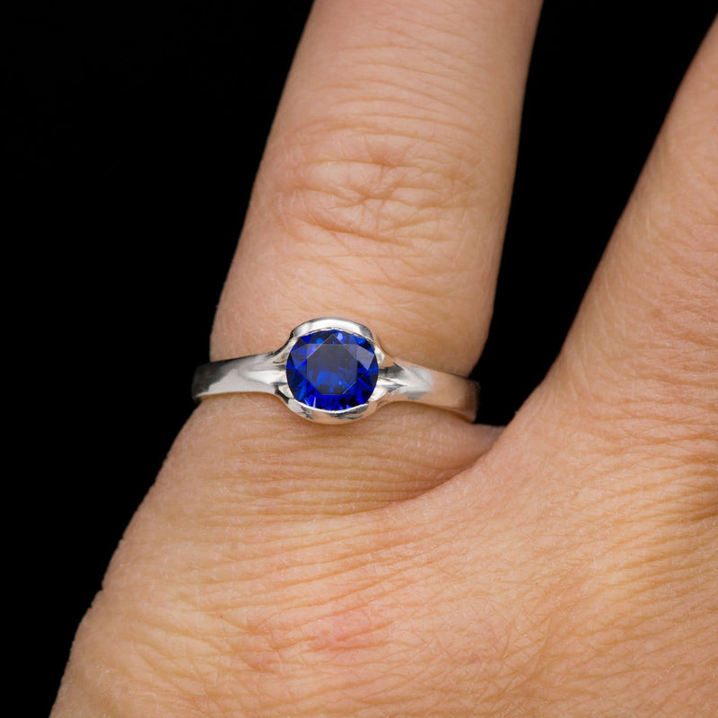 Lab Created Round Blue Sapphire Half Bezel Fold Solitaire Ring in Sterling Silver, Ready to Ship
