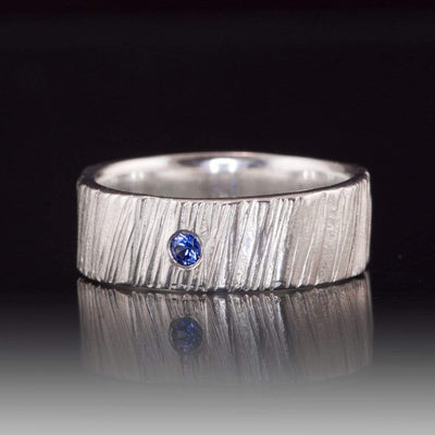 Wide Saw Cut Texture Wedding Band With Flush Set Blue Sapphire