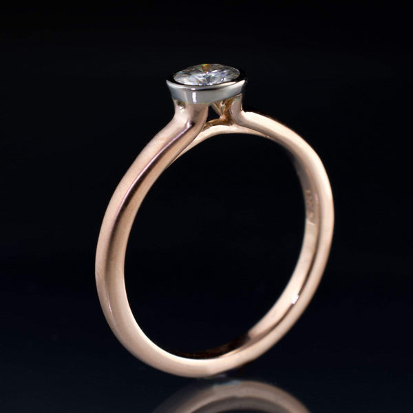rose gold and palladium moissanite ring