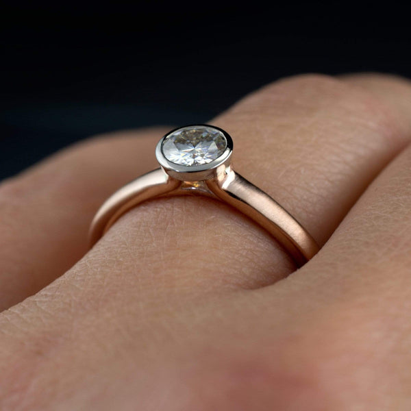 Moissanite on  rose gold and palladium  ring on hand