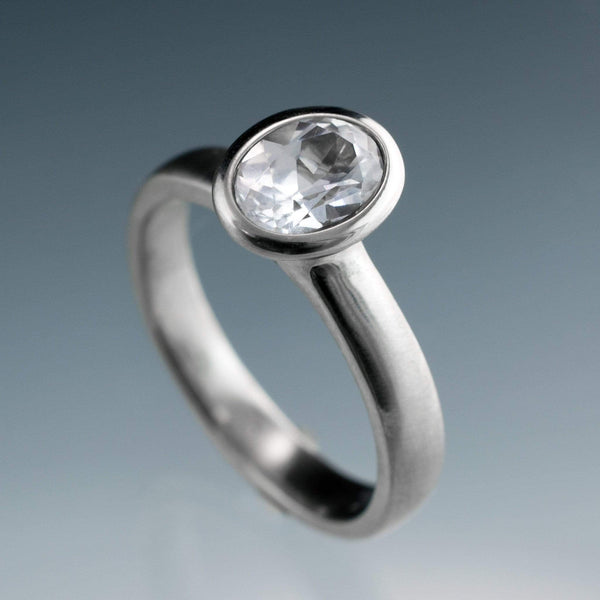 Genuine Oval White Sapphire Bezel Solitaire Engagement Ring - by Nodeform