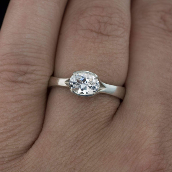 Oval White Sapphire Half Bezel Fold Solitaire Engagement Ring