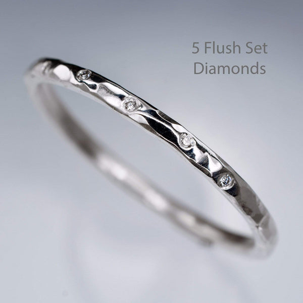 skinny diamond flush set hammered wedding ring