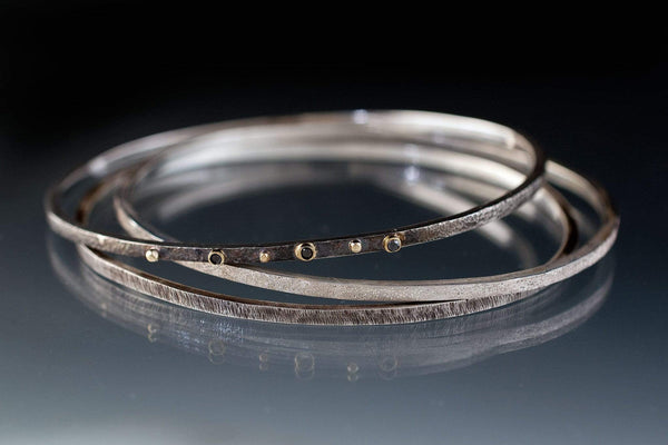 Three Thin Textured Silver Bracelets with Black Diamonds and 18k Gold