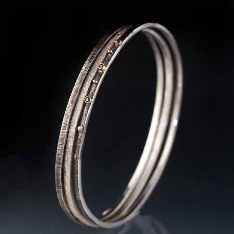 Three Thin Textured Silver Bracelets with Black Diamonds and 18k Gold - by Nodeform