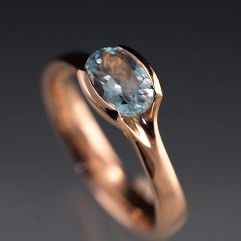 Rose gold and oval Aquamarine engagement ring
