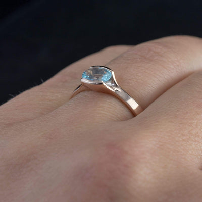 Oval Aquamarine Fold Solitaire Engagement Ring