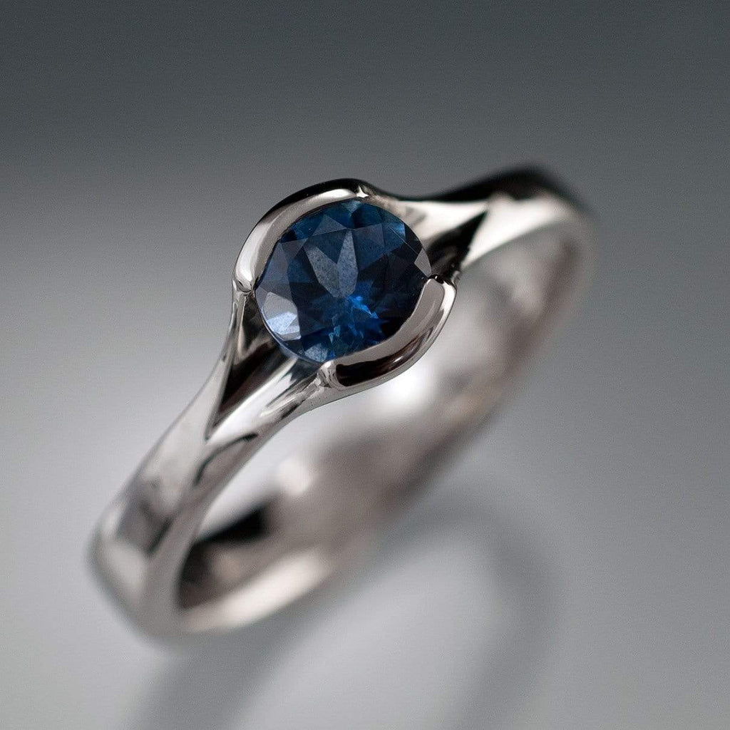 round fair trade blue green sapphire fold engagement ring