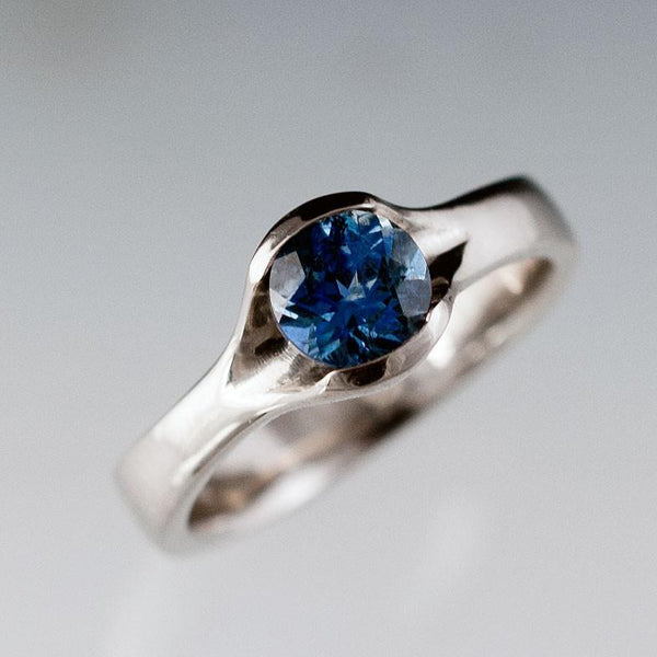 Round Fair Trade Blue / Green Sapphire Fold Engagement Ring
