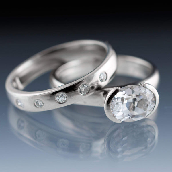 Oval White Sapphire Half Bezel Solitaire Ring & Moissanite Wedding Band Bridal Set - by Nodeform