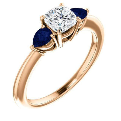 Tressa- Three Stone Engagement Ring, Prong set Cushion Moissanite & Pear Blue Sapphire Accents