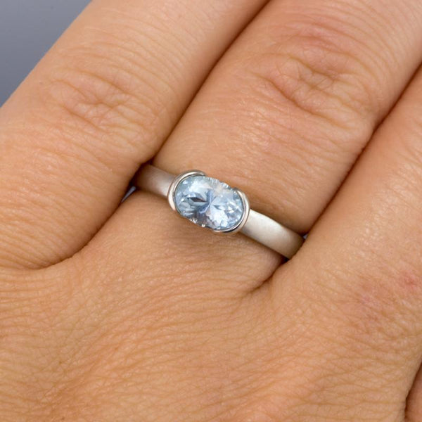 Oval Aquamarine Half Bezel Solitaire Engagement Ring