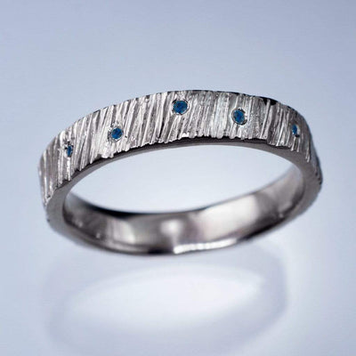 Saw Cut Texture Wedding Band With Blue Sapphire Accents