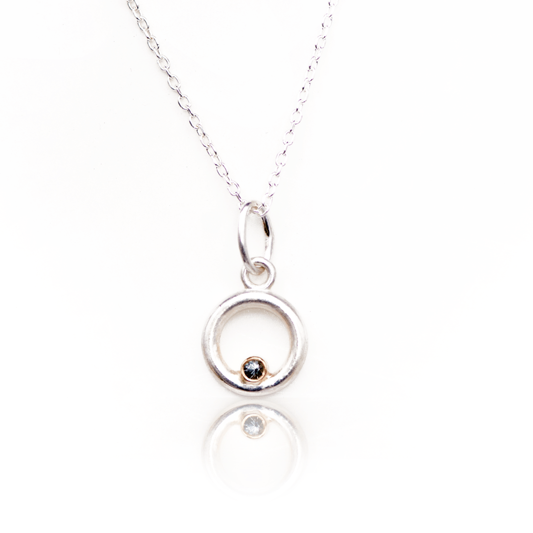 Sterling silver Circle pendant necklace with pastel Blue Montana Sapphire in 14k Gold Bezel