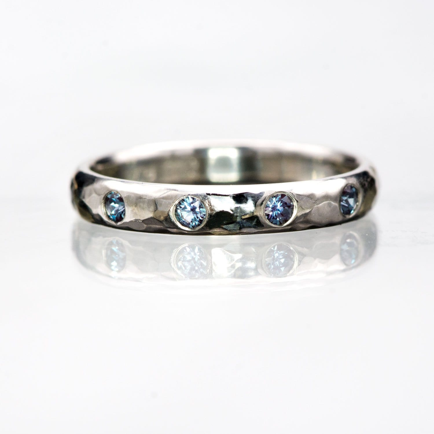 Narrow Hammered Texture Wedding Band With Flush Set Alexandrites