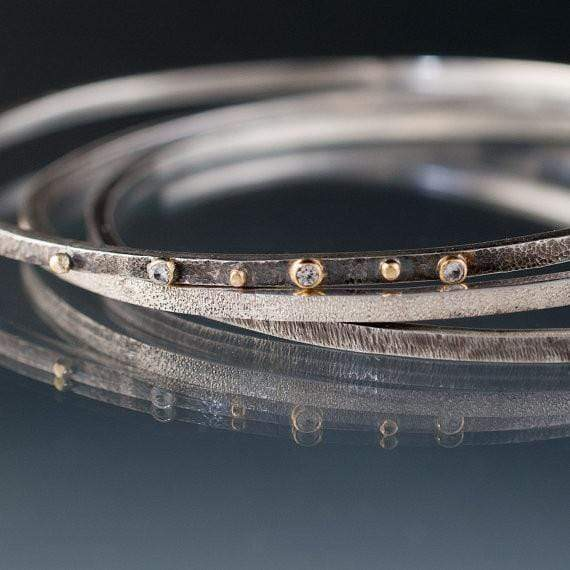 Three Textured Silver Bracelets with White Sapphires and 18k Gold Accents