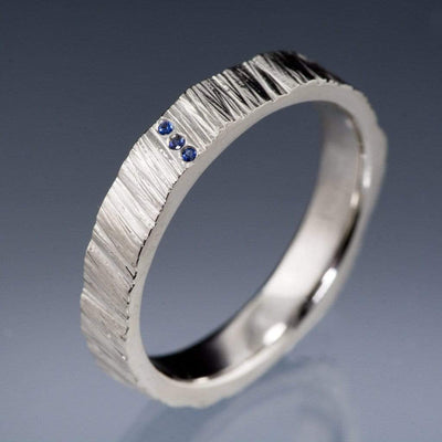 Saw Cut Texture Wedding Band With 3 Blue Sapphire Accents