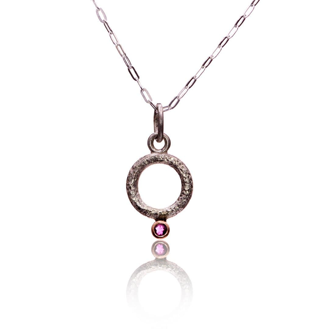 Sterling silver circle pendant necklace with Ruby in 14k Rose Gold Bezel