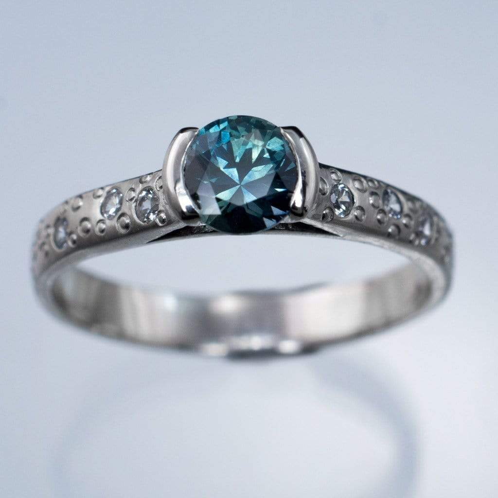 moissanite white half fair star engagement by dust montana blue teal trade bezel products sapphire ring