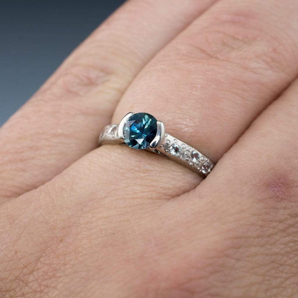 bridal set ring in moissanite and a blue ctw dzbs diamond with round sapphire platinum piece
