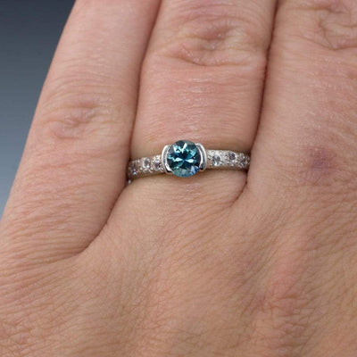 Fair Trade Teal/Blue Montana Sapphire Half Bezel Moissanite Star Dust Engagement Ring - by Nodeform