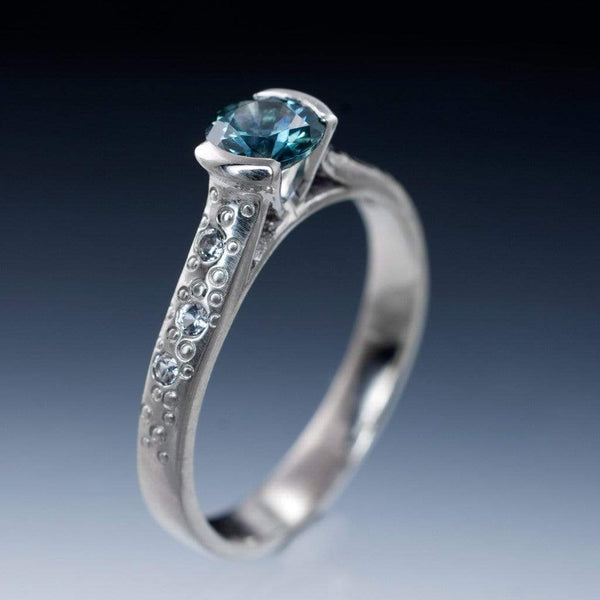 Fair Trade Teal/Blue Montana Sapphire Half Bezel White Sapphire Star Dust Engagement Ring