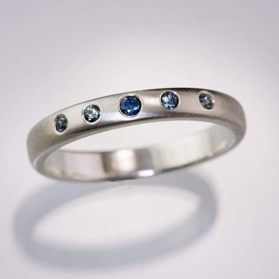 Domed Wedding Band with Graduated Flush set Montana Sapphire