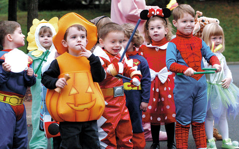 Adorable Kids at Halloween in dressed in Costumes