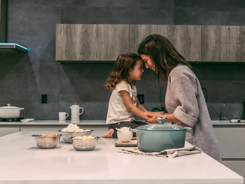 mom and daughter at the kitchen
