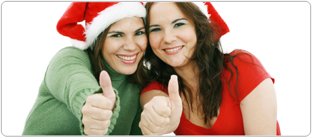 Two women in green(left) and red(right) giving a thumps up