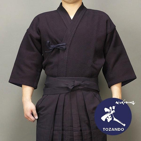 Dogi worn with hakama, front view.